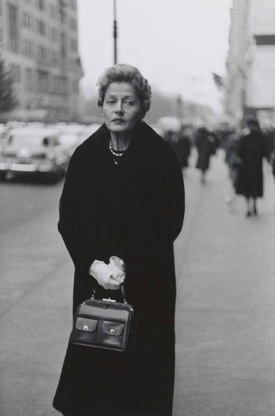 MONROWE - Woman with white gloves and a pocket book, N.Y.C. 1956 © The Estate of Diane Arbus, LLC. All Rights Reserved