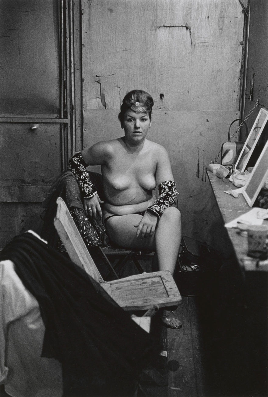 MONROWE - Stripper with bare breasts sitting in her dressing room, Atlantic City, N.J. 1961 © The Estate of Diane Arbus, LLC. All Rights Reserved