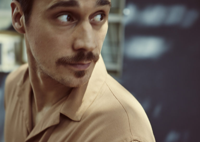 MONROWE Magazine, Peter Gadiot, Photographer: Stefano Ortega. Tan Silk Shirt by Topshop Navy Cotton Chino Pants by Acne