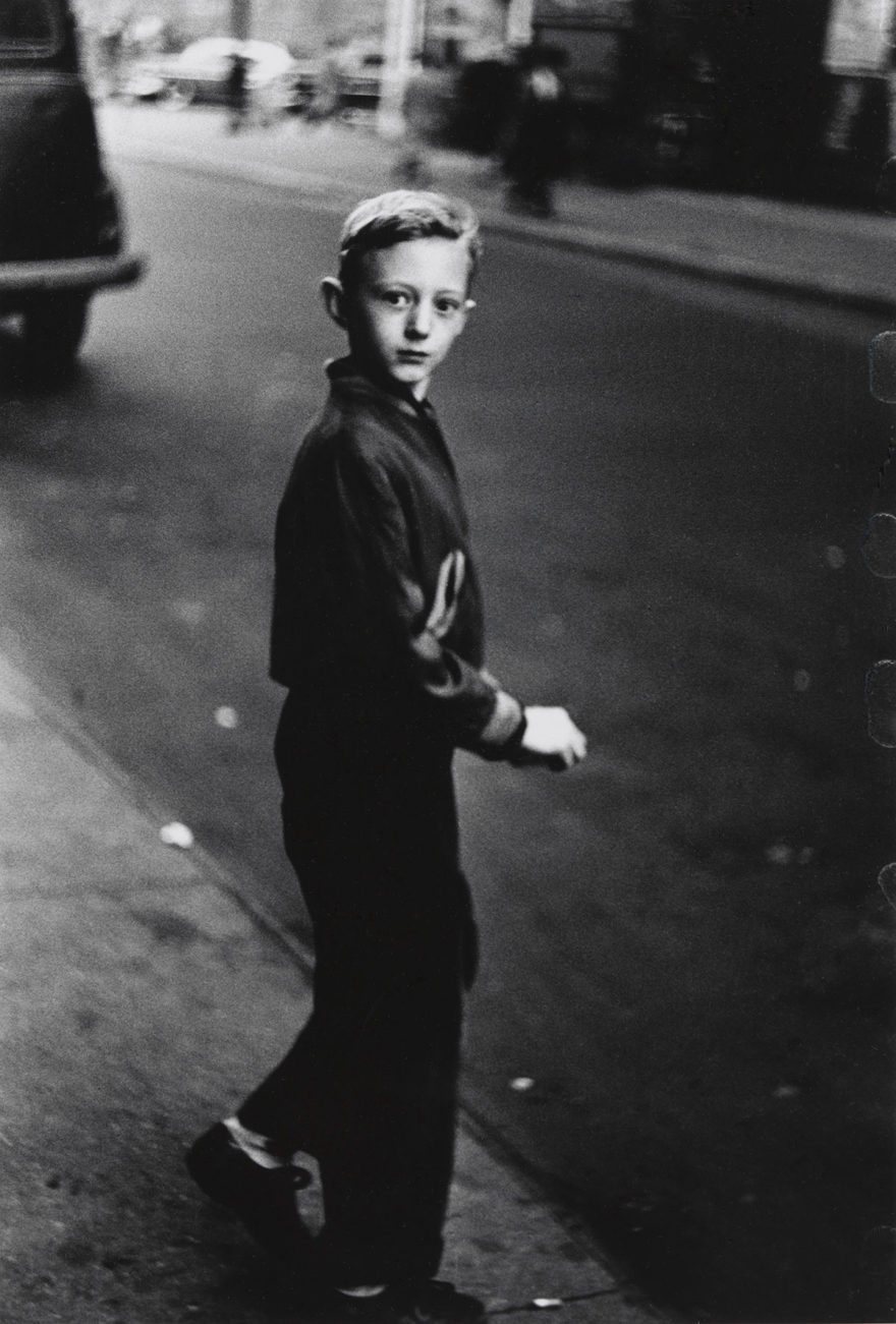 MONROWE - Boy stepping off the curb, N.Y.C. 1957–58 © The Estate of Diane Arbus, LLC. All Rights Reserved