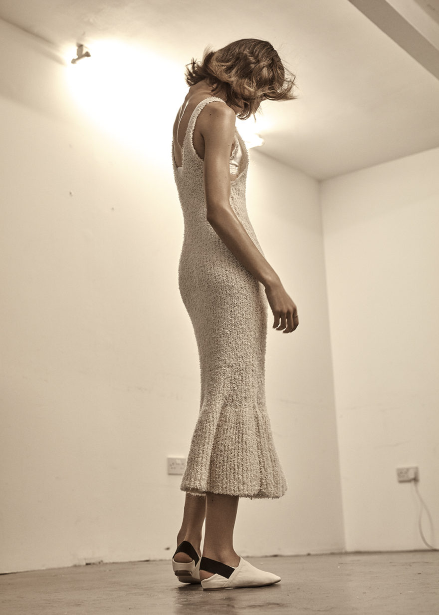 MONROWE Magazine: Photographer David Paul Vail, Stylist - Emily Dawes Hair - Naomi Regan  Make-up - Mirijana Vasovic  Model - Alina @IMG London. Oatmeal knitted stretch midi dress by by MALENE BIRGER, White cotton and lace triangle bra by BARE LONDON, White slip on shoes by H&M STUDIO