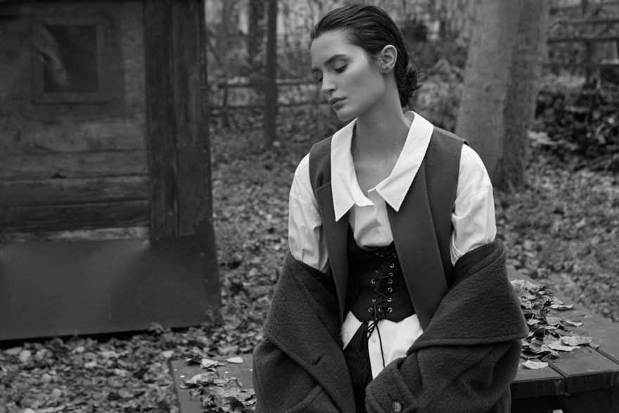 Tania Onishchenko in forest. White cotton shirt ARMANI coat ROBERTO VERINO waistcoat MOSCHINO pants LOEWE vest MASSIMO DUTTI