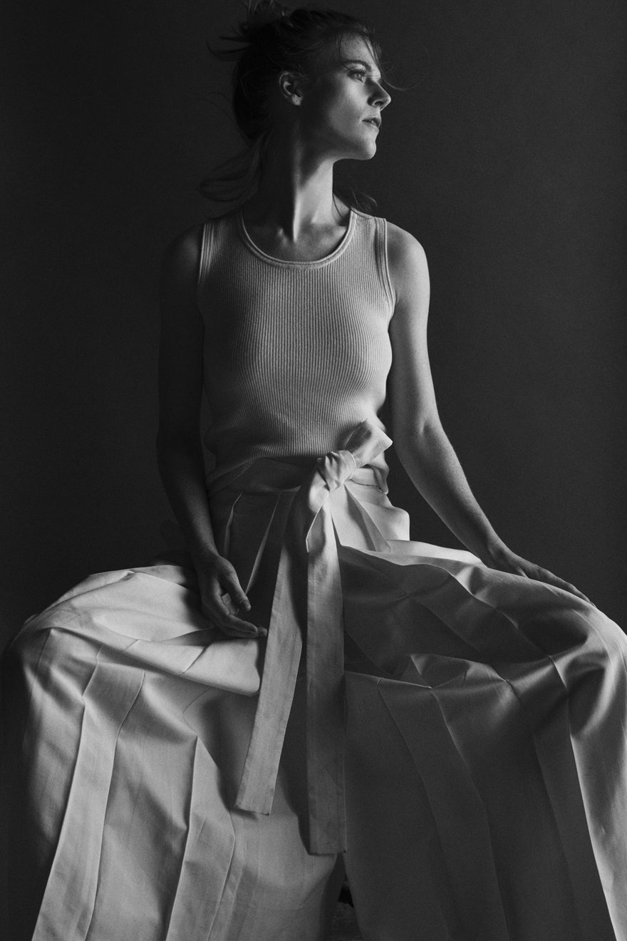 Rose Leslie wearing The Row and M.Martin for MONROWE Magazine. Black and white photography by Krisztian Eder.