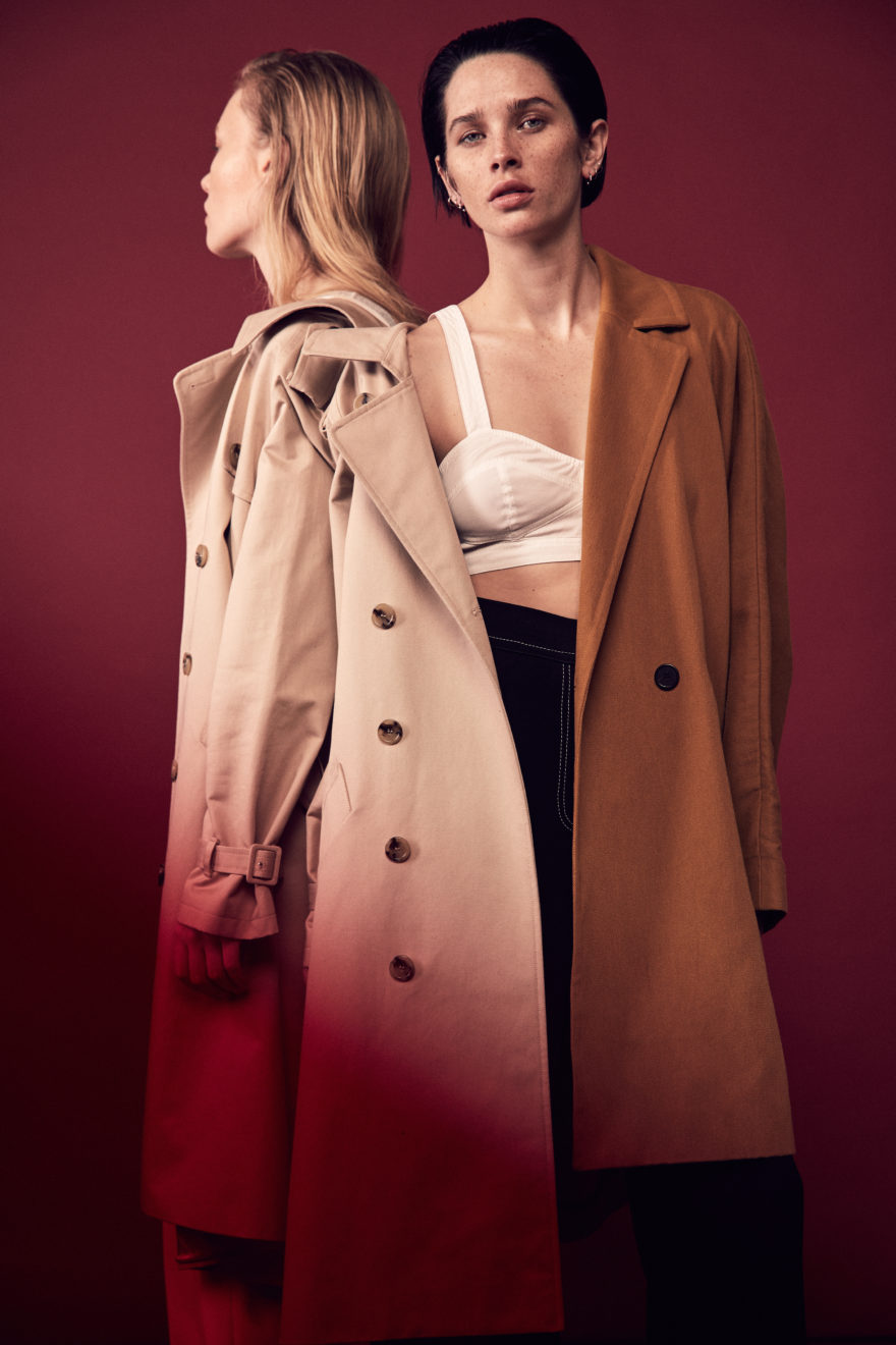 MONROWE - photo by Lauren Loncar, Sara Cummings, Eden - caramel coat; Iro. top and pants; A.L.C. trench coat; Lacoste. Two Models in studio with red background