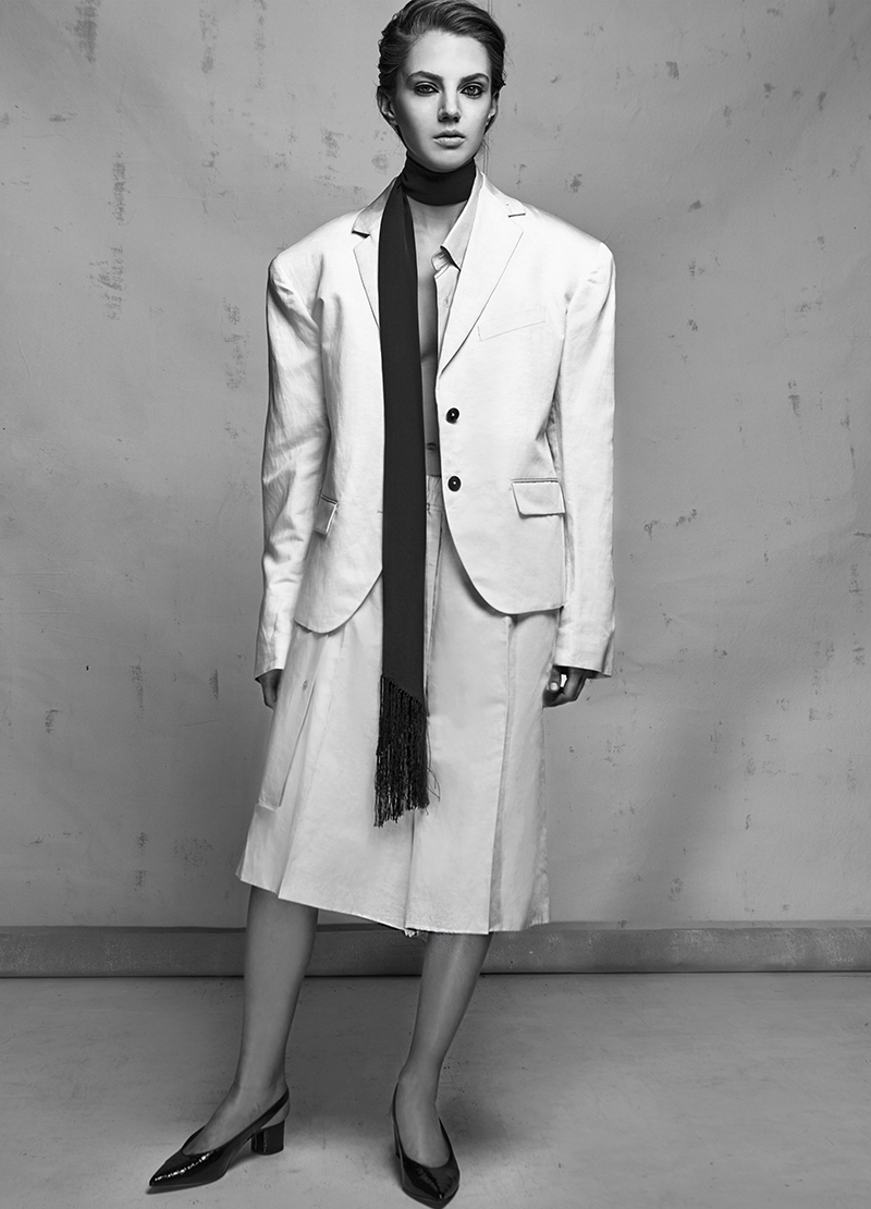 Viviane Michelis, New York Models for MONROWE Magazine in Black & White, Studio. Woman with white jacket in photo studio.