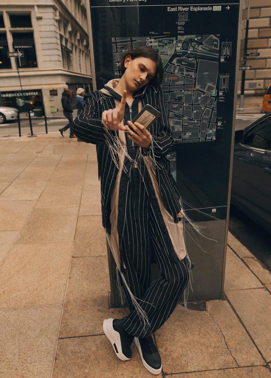 Model in street looking at camera for Monrowe Magazine. DKNY, Supreme Models, Gabriela Celeste