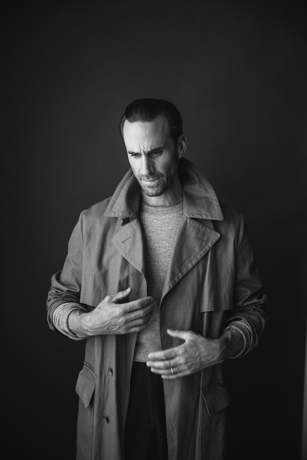 Photo of Actor Joseph Fiennes, from Handmaid's Tale photographed in studio in black and white. Wearing APC, Billy Reid