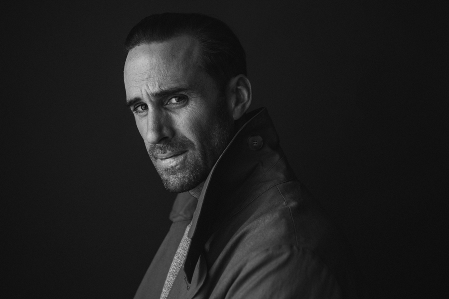 Photo of Actor Joseph Fiennes, from Handmaid's Tale photographed in studio in black and white. Wearing APC