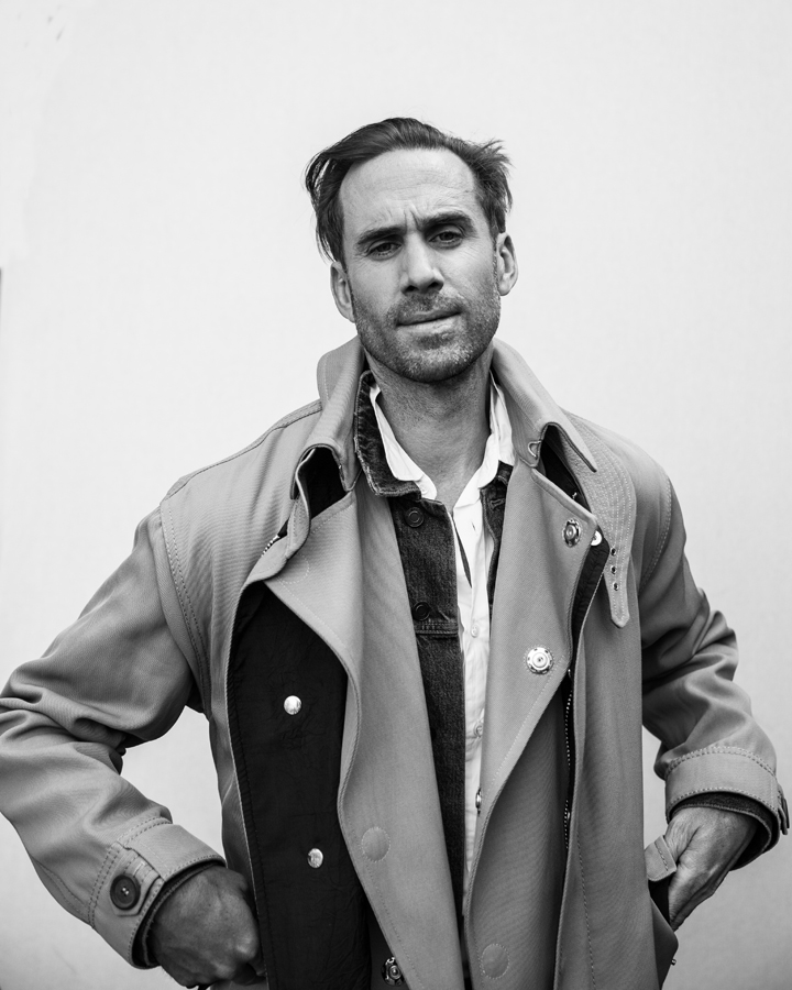 Photo of Actor Joseph Fiennes, from Handmaid's Tale photographed in studio in black and white. Wearing Giorgio Armani, Saint Laurent, and Maison Margiela
