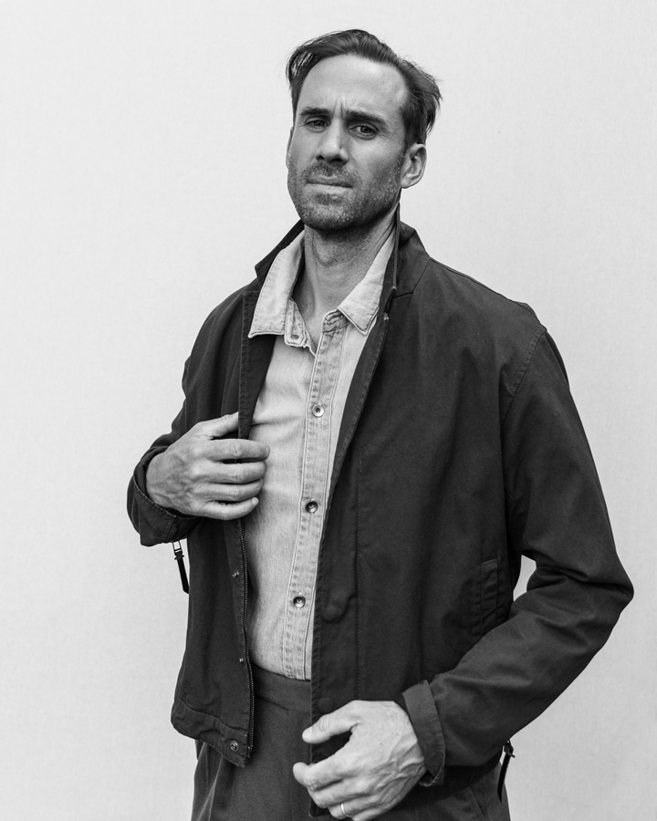 Photo of Actor Joseph Fiennes, from Handmaid's Tale photographed in studio in black and white wearing Robert Geller