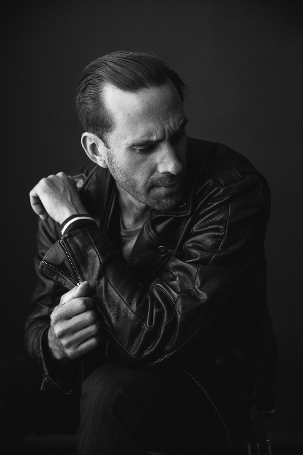 Photo of Actor Joseph Fiennes, from Handmaid's Tale photographed in studio in black and white.