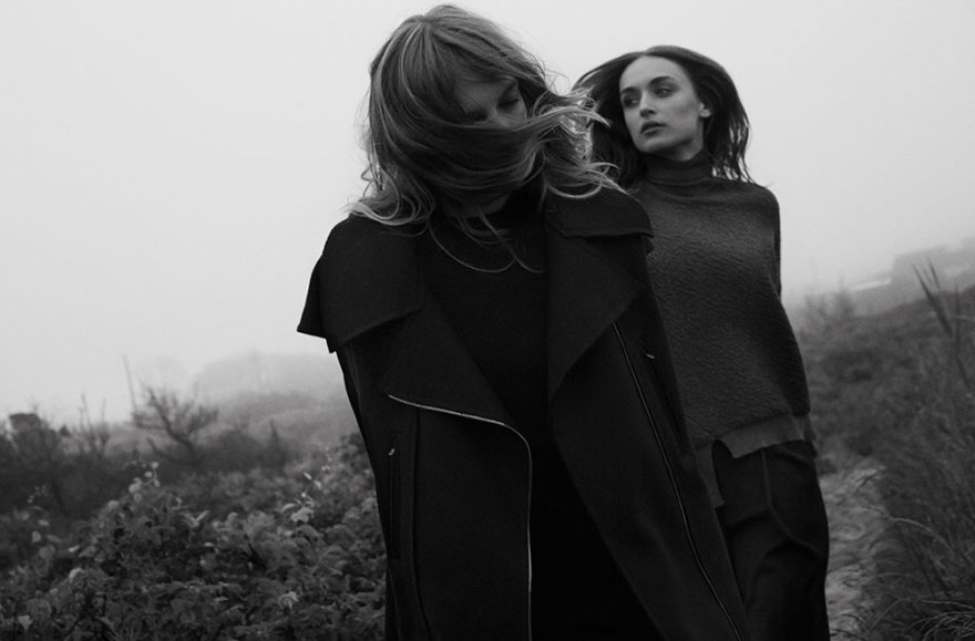 Models Yulia and Stasha photographed in black and white by photographer Vera Comploj for MONROWE Magazine. Yulia in Black Turtleneck Dress by Behno Black Gilet Coat by Tamuna Ingorokva Lace Up Platform Shoes by Sacai and Stasha in Grey Turtleneck and Navy Trousers by Behno Platform LaceUp Shoes by 3.1 Phillip Lim.