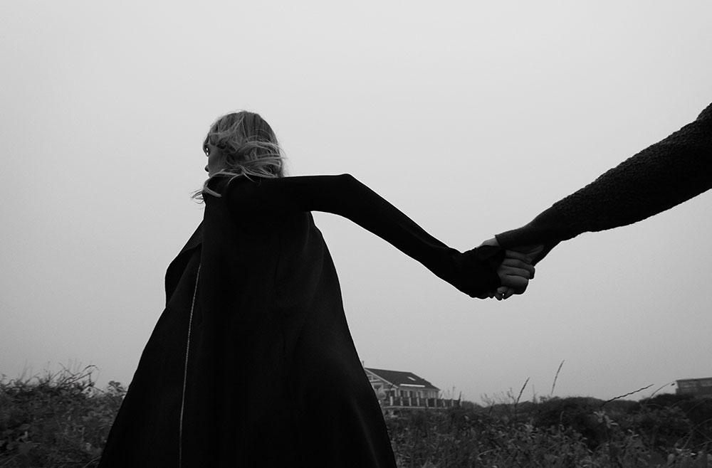 Models Yulia and Stasha photographed in black and white by photographer Vera Comloj for MONROWE Magazine. Yulia in Black Turtleneck Dress by Behno Black Gilet Coat by Tamuna Ingorokva, Stasha in Grey Turtleneck and Navy Trousers by Behno