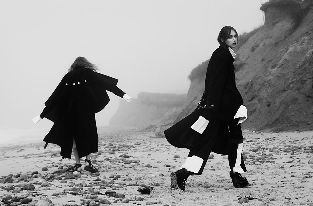 Models Yulia and Stasha photographed in black and white by photographer Vera Comploj for MONROWE Magazine. Yulia in oversized Button-Up Shirt and Wool Coat by Daniel Gregory Natale and Stasha in Navy French Cuff Dress and Black Trousers with White Side Stripe and Wool Coat by Devon Halfnight Leflufy Platform LaceUp Shoes by Sacai.
