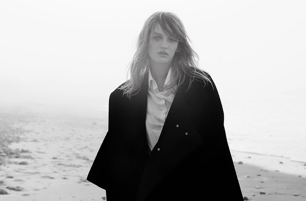 Black and white photograph by photographer Vera Comploj for MONROWE Magazine. Oversized Button-Up Shirt and Wool Coat by Daniel Gregory Natale