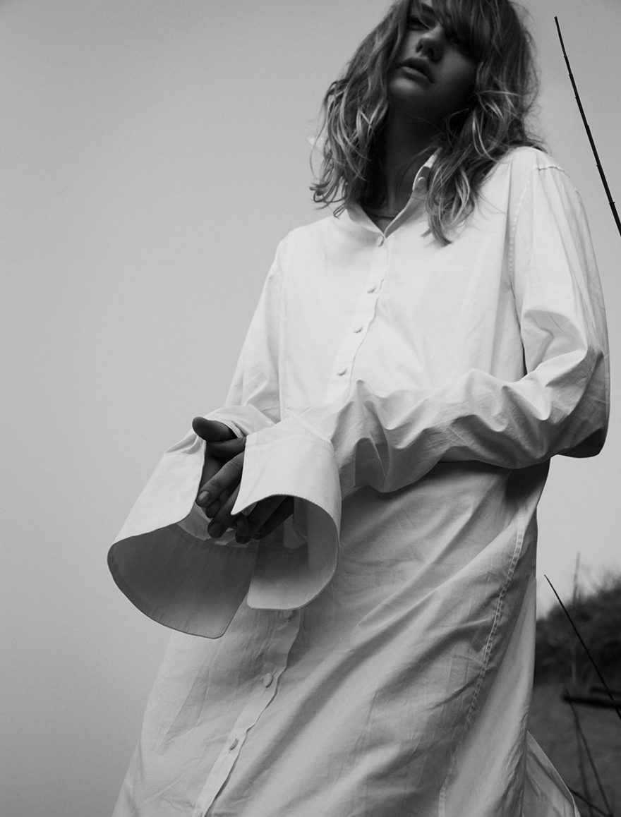 Model Yulia photographed in black and white by photographer Vera Comploj for MONROWE Magazine. White Oversized Shirt by Daniel Gregory Natale