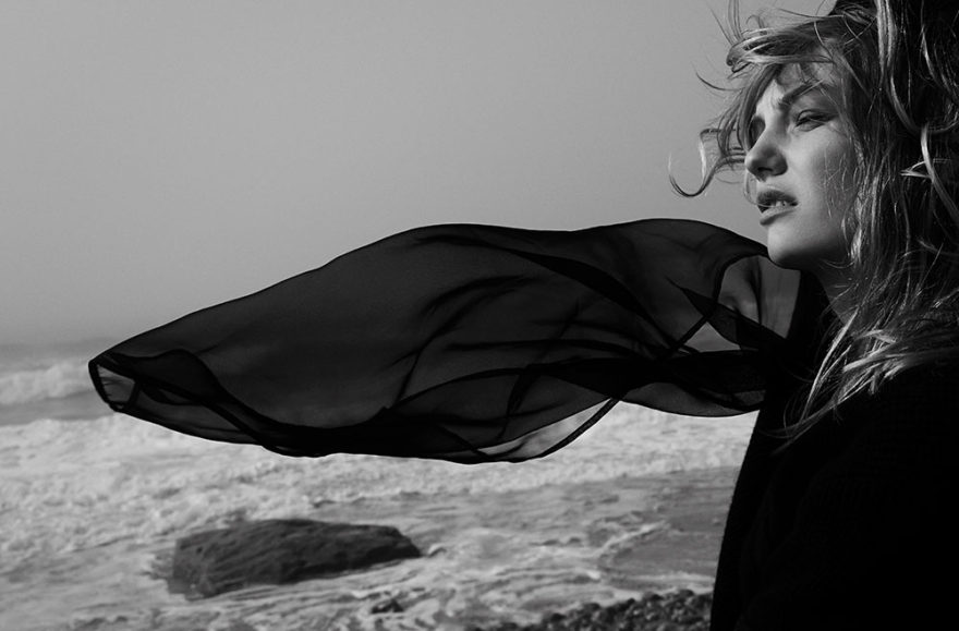 Black and white photograph by photographer Vera Comploj for MONROWE Magazine. Black Knit Blouse by Sacai
