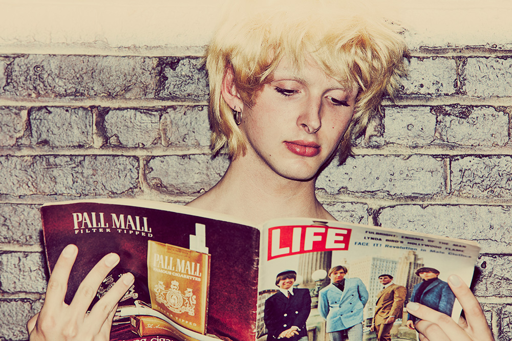 Colton Rabon shot in color by Anna Palma. Holding LIFE magazine.