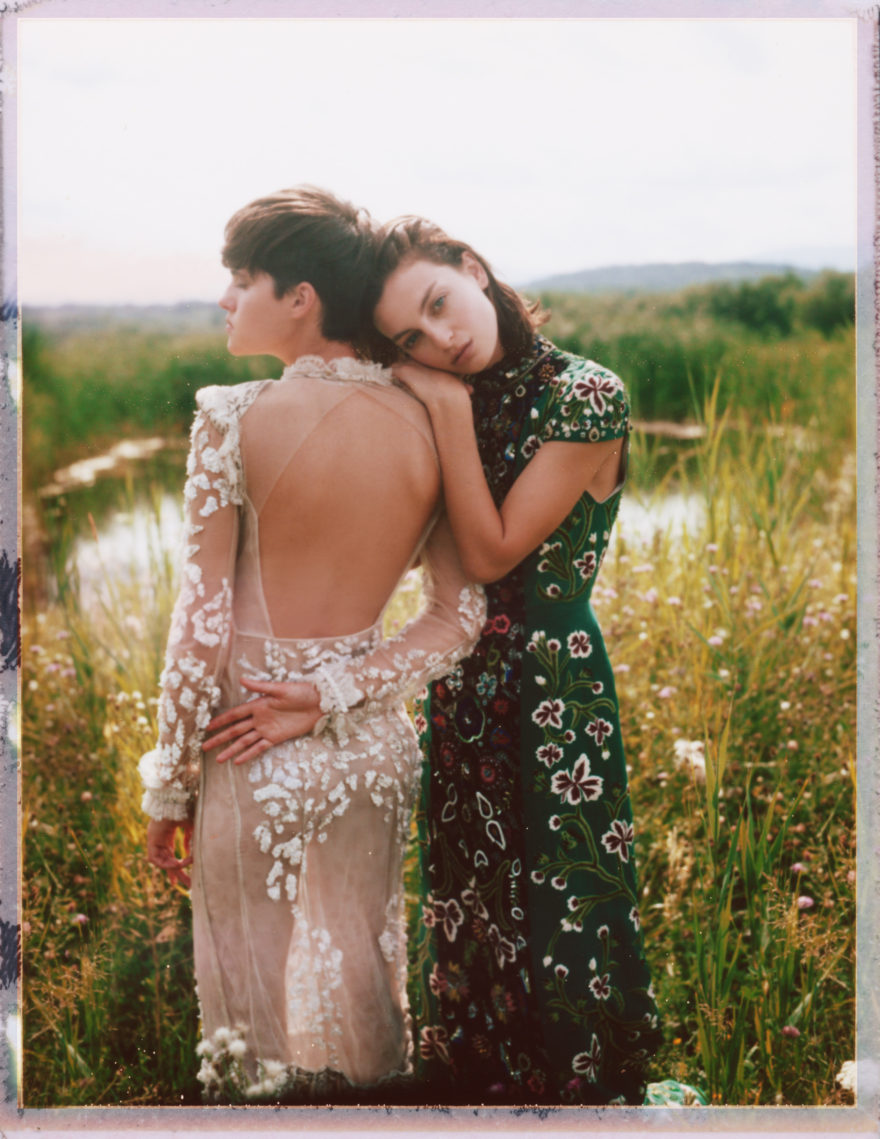 Colored image of MUSE models Rose Smith and Maria Kudry on green field wearing Roberto Cavalli and Alice and Olivia by Stacey Bendet