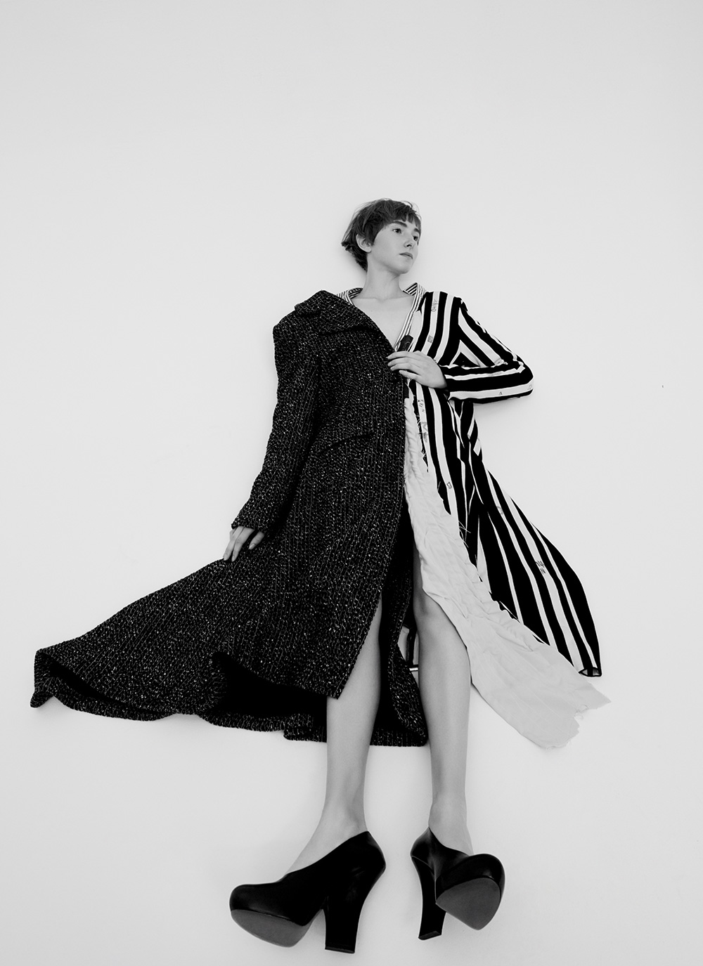 Black and white image by Ricardo Beas of model Mary Tish laying on the floor for MONROWE Magazine