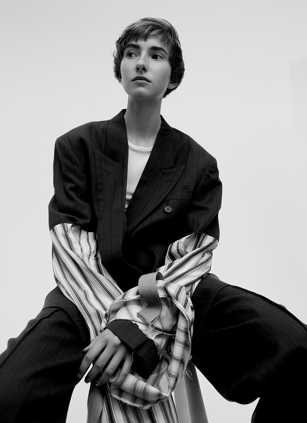 Black and white image by Ricardo Beas of model Mary Tish in oversized shirt for MONROWE Magazine