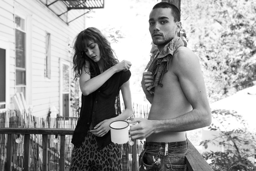 Black and white photo of models Adriana Bexa and Miles Frank drinking coffee by photographer Rami Pyrdol for MONROWE Magazine