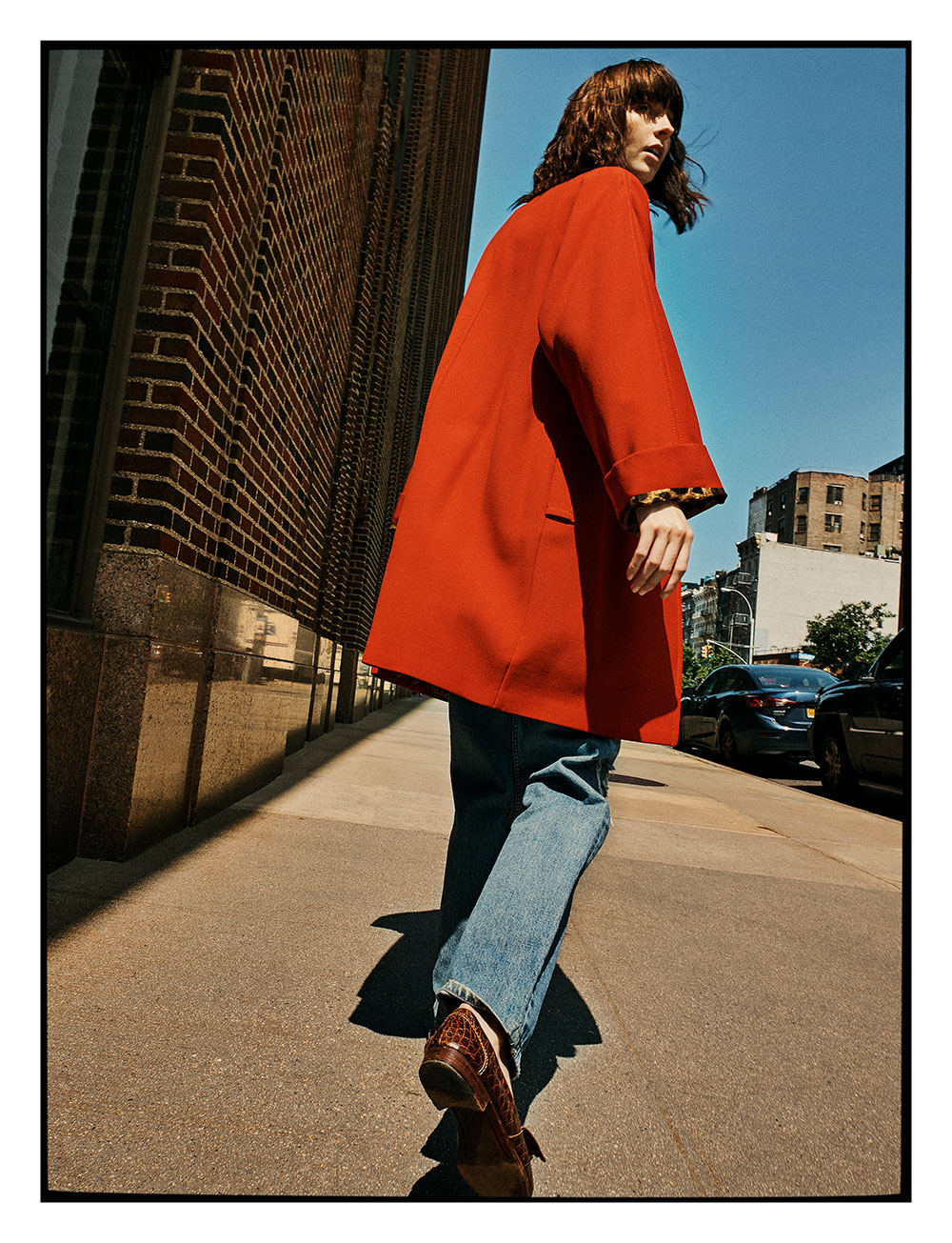 Photo by Jake Jones of model Kara Gall in red coat for MONROWE magazine