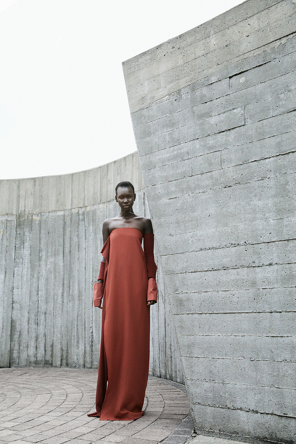 Colored photo by Lauren Loncar of model Adot in red dress for MONROWE magazine