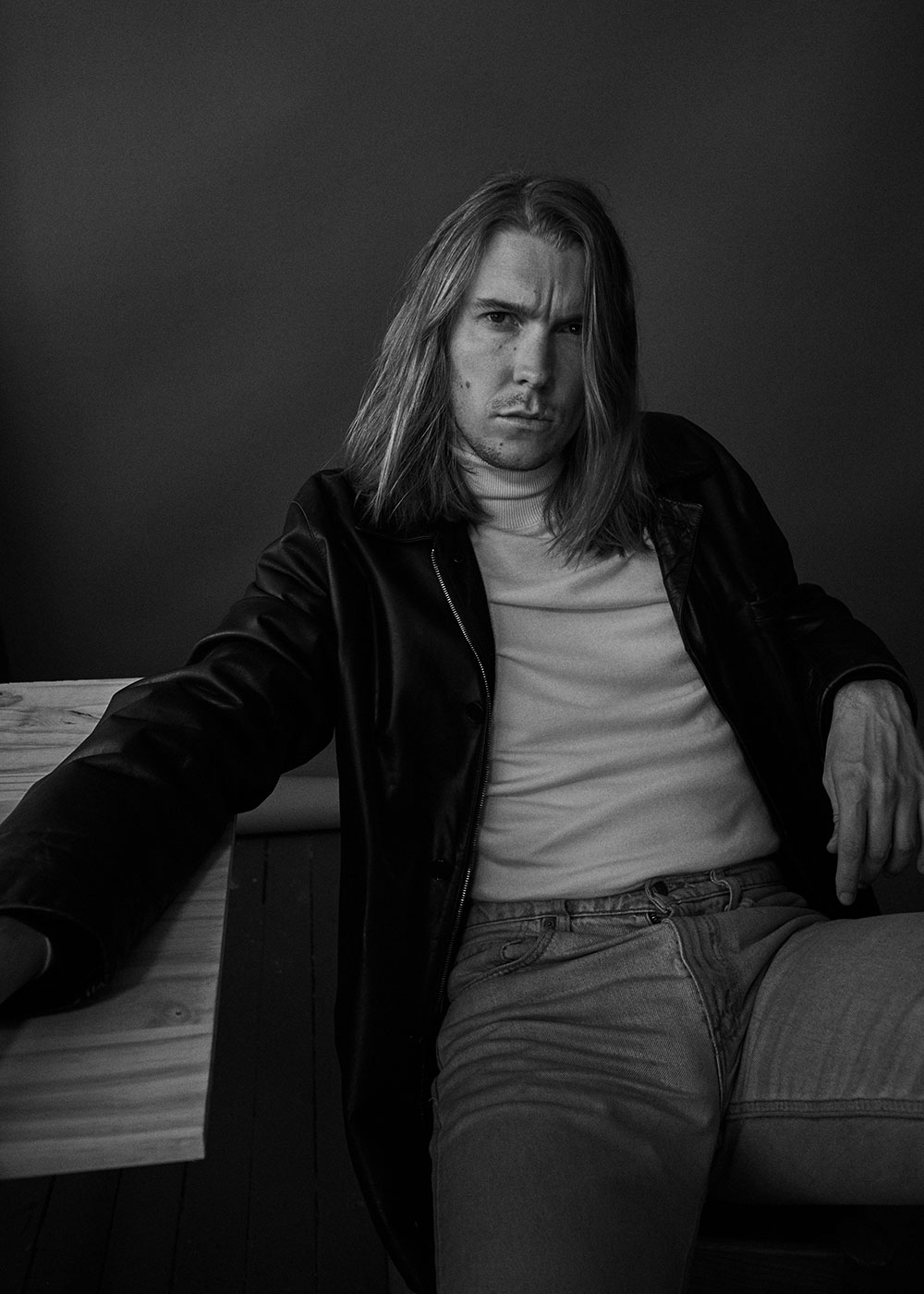 Black and white photo of Alex Cameron by JackO'Connor for MONROWE Magazine