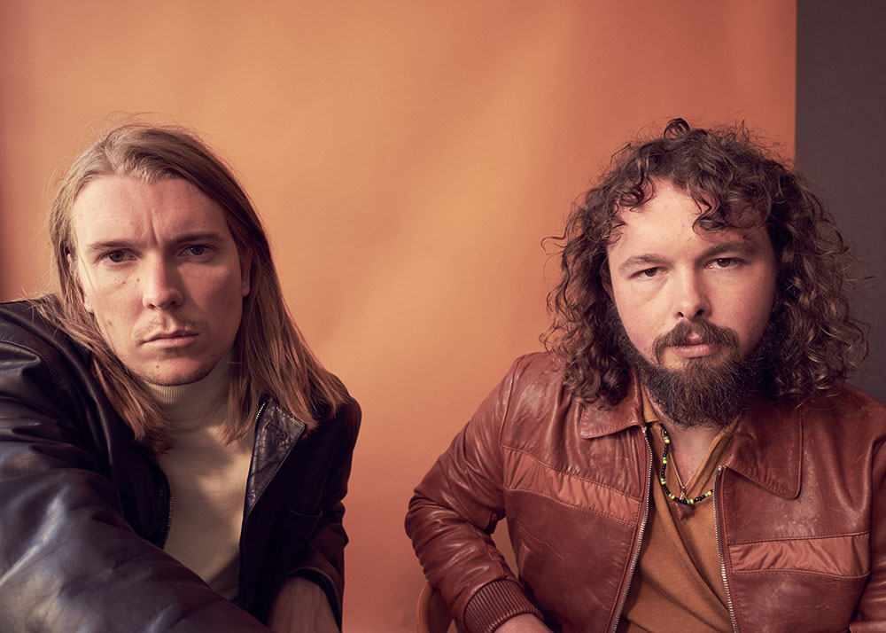 Colored photo of musicians Alex Cameron and Roy Molloy by JackO'Connor for MONROWE Magazine