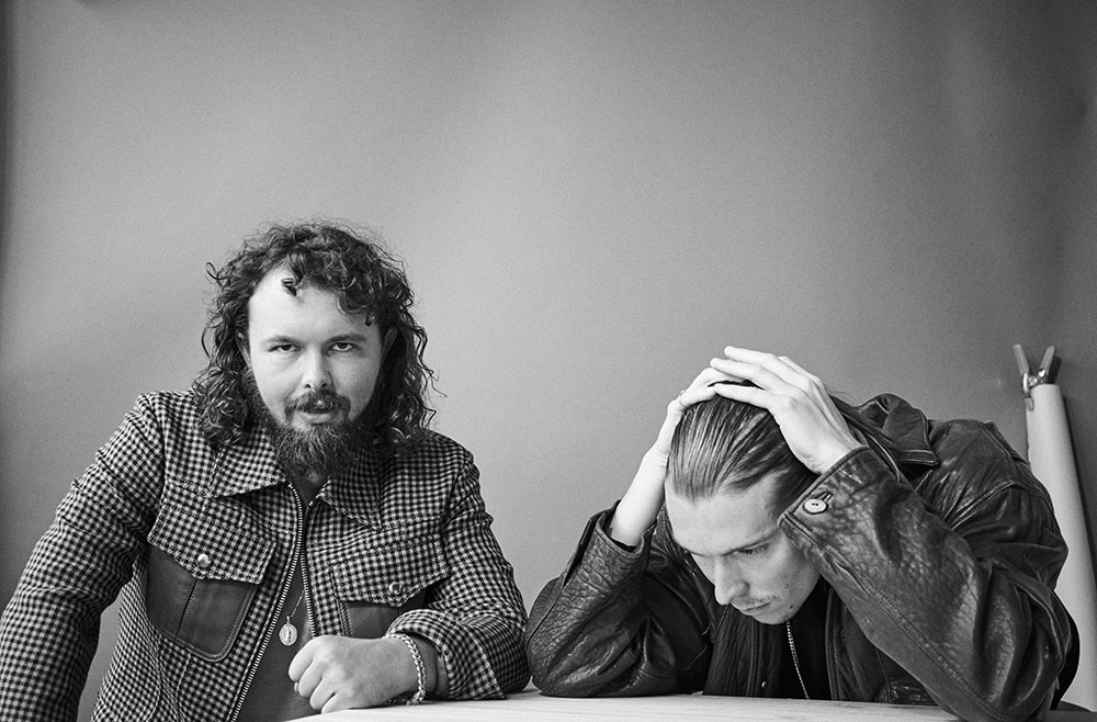 Black and white photo of Alex Cameron and Roy Molloy by JackO'Connor for MONROWE Magazine