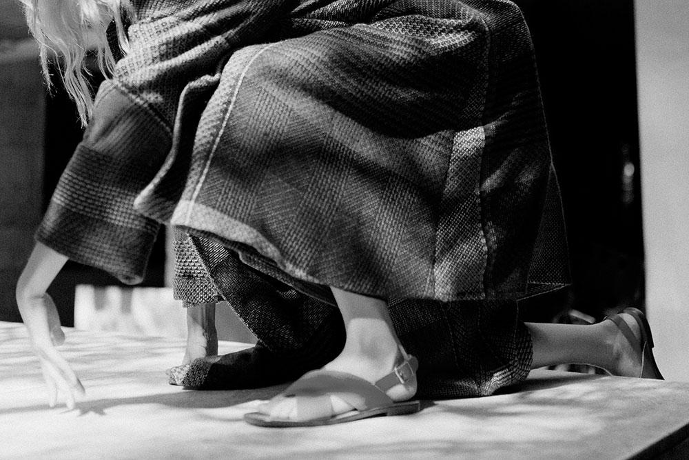 Black and white photo by Edgar Berg of model Tyg Davison in Dusan clothing for MONROWE magazine
