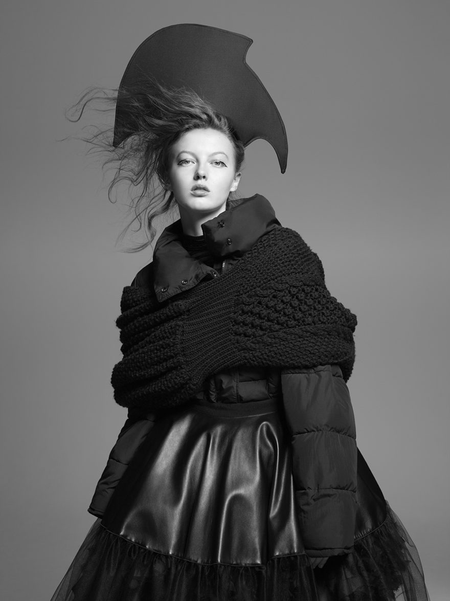 Hat by J.R. MALPERE, Jacket by MONCLER. Sweater dress by KENZO, Skirt by GIAMBA